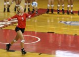 Katie Reeves serves for the Lobos at the Gallego center.