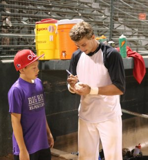 Billy Crowe takes time out for a fan after the game. (Courier Photo: Bryon Garrison)