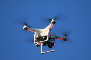 Cool overhead camera drone was zooming overhead, filming a Cowboy's commercial. (Courier Photo: Bryon Garrison)