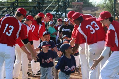 Little League teams meet the Cowboys on opening day. (Courier Photo: Destiny Cross)