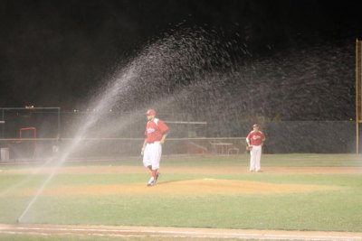 In the top of the ninth, the sprinkler system came on. Luckily one of the coaches was on the job and cut off the sprinkler quickly. (Courier Photo: Bryon Garrison)